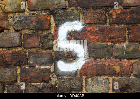 NUMBER 5 ON PAINTED ON A BRICK WALL, SOUTHEND-ON-SEA, ESSEX, UK - Stock Photo