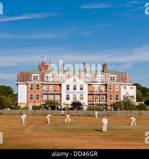 A cricket match takes place outside the Balmer lawn Hotel in Brockenhurst , Hampshire , England , Britain , Uk - Stock Photo
