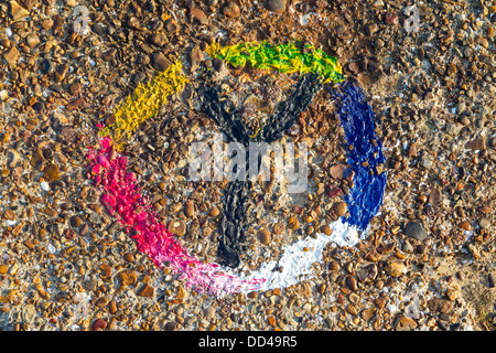 RAINBOW PEACE SIGN PAINTED ON SEA WALL, SOUTHEND-ON-SEA, ESSEX, UK - Stock Photo