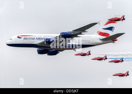 Red Arrows aerobatic team in formation with a BA A380 super jumbo - RIAT 2013 - Stock Photo