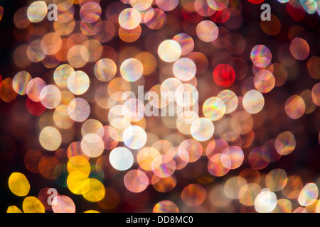 abstract pink, red and yellow oval shaped highlights which are out of focus backlit glass spheres - Stock Photo