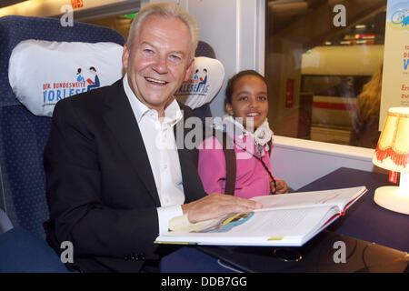 Deutsche Bahn railway company chairman Ruediger Grube reads a book to pupils from the St. Ursula elementary school - Stock Photo