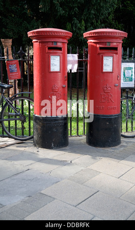 Two traditional red pillar post boxes Cambridge England - Stock Photo