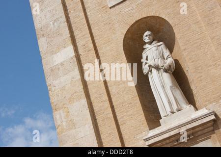 Statue of St Francis of Assisi, Basilica of Santa Maria degli Angeli, Assisi, Italy - Stock Photo