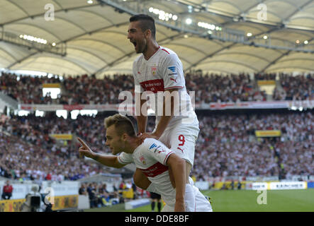 Stuttgart's Alexandru Maxim celebrates the 3-1 goal with Vedad Ibisevic (top) during the German Bundesliga match - Stock Photo