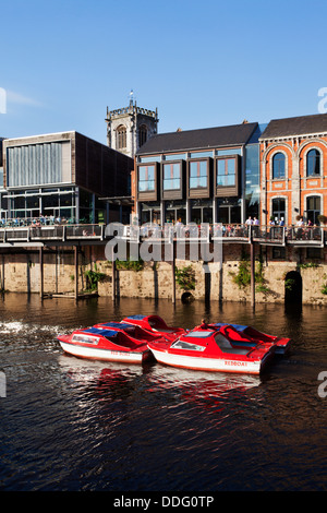 Moving Boats along the River Ouse near City Screen City of York Yorkshire England - Stock Photo