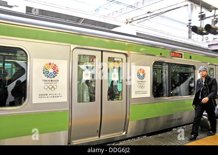 Tokyo candidate city of 2020 Olympic games sign on train Shinjuku Tokyo Japan - Stock Photo