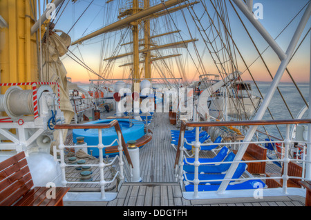 Pool and lounge chairs at the deck of a royal clipper ship, Italy - Stock Photo