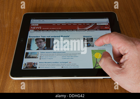 BBC news website displayed on an Apple iPad tablet computer - Stock Photo