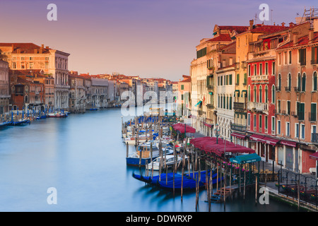 Sunrise in Venice from the Rialto Bridge with the view on the Grand Canal - Stock Photo