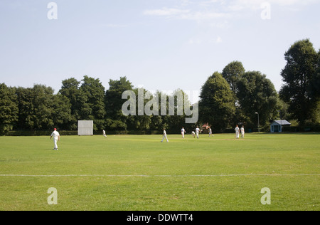 Littlebourne Kent England UK Local village team formed 1860 playing cricket match at recreation club - Stock Photo