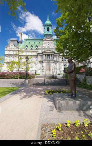 Montreal City Hall (Hotel de Ville) near Place Jacques Cartier in Old Montreal (Vieux Montreal). The statue of Jean - Stock Photo