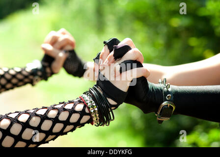 Women, Gothic, holding hands - Stock Photo