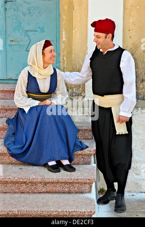 Young couple wearing traditional costumes in Palaio ('old') Karlovasi, Samos island, Greece. - Stock Photo