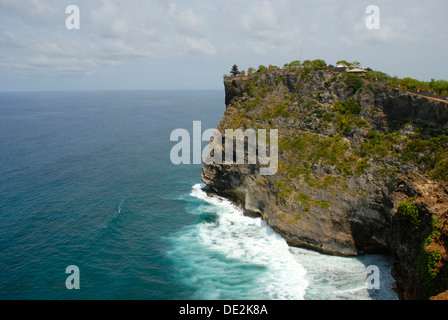 Balinese Hinduism, sanctuary on a cliff high above the sea, Pura Luhur Uluwatu temple, Bukit peninsula, Bali, Indonesia - Stock Photo
