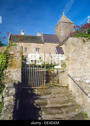 The approach to St Seiriol's church, Penmon, Anglesey, and the cloister court (now a garden) of the former Augustinian - Stock Photo