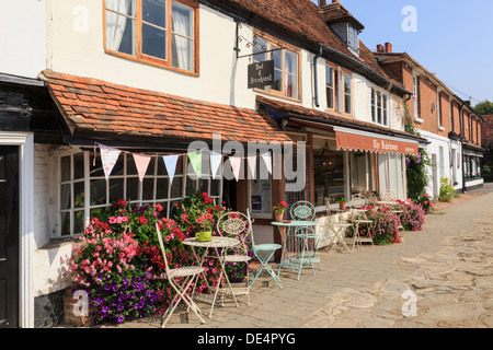 Chairs and tables outside The Bakehouse cafe on the main street in Biddenden, Kent, England, UK, Britain - Stock Photo