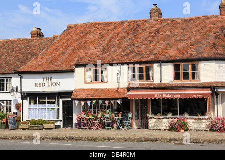 The Bakehouse cafe and Red Lion pub in old buildings with red tiled roof in Biddenden, Kent, England, UK, Britain - Stock Photo