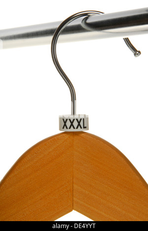 Empty clothes hanger with XXL size sign - Stock Photo