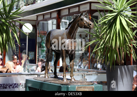 Red Rum Statue in the Wayfarers Shopping  Arcade at Southport - Stock Photo