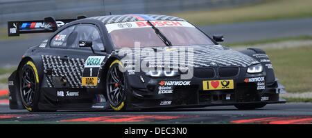 Oschersleben, Germany. 15th Sep, 2013. The Canadian BMW-Pilot Bruno Spengler drives his race car on the racetrack - Stock Photo
