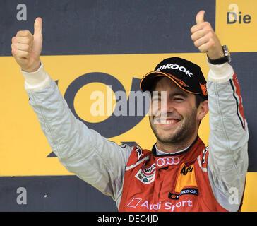 Oschersleben, Germany. 15th Sep, 2013. The German Audi-Pilot Mike Rockenfeller celebrates after winning second place - Stock Photo