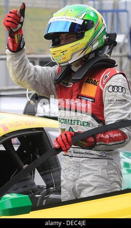 Oschersleben, Germany. 15th Sep, 2013. The German Audi-Pilot Mike Rockenfeller celebrates winning the second place - Stock Photo