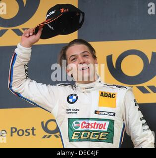 Oschersleben, Germany. 15th Sep, 2013. The Brazilian BMW-Pilot Augusto Farfus cheers after winning the 8th race - Stock Photo