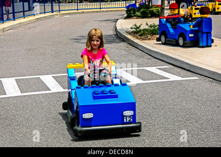 Young girl driving a vehicle at the Legoland Junior Driving School Florida - Stock Photo
