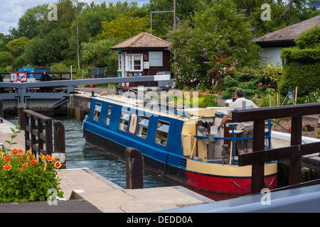 Narrowboat using St John's Lock on the River Thames near Lechlade - Stock Photo