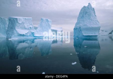 Iceberg in reflection. Andvoord Bay. Antarctic Peninsula.  Antartica - Stock Photo