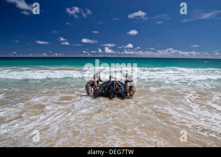 A US Marine Battalion Landing Team conduct training with a combat rubber reconnaissance craft on the beach August - Stock Photo