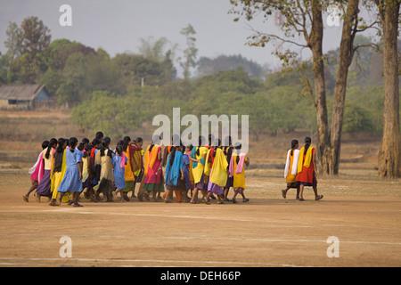 Girls walking on road, Orissa, India - Stock Photo