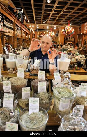 Ciro Forte showing salt pearls from Assal lake, standing behind various kind of salt display, Girofle & Cannelle - Stock Photo