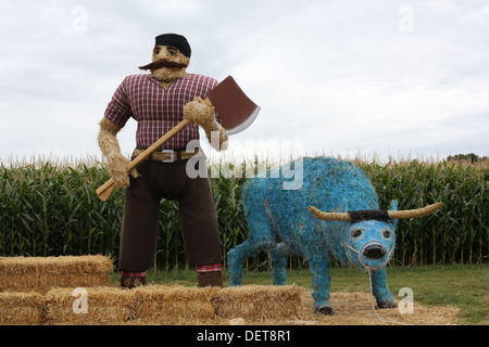 Statues of Paul Bunyan and Babe the Blue Ox made out of hay at Sever's Corn Maze in Shakopee, Minnesota. - Stock Photo