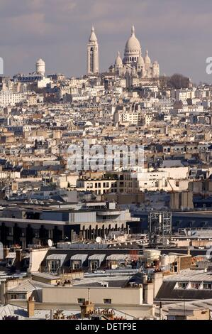 View over the Basilica Sacre Coeur and the roofs of Paris, France - Stock Photo