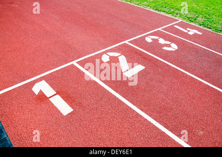Closeup of the numbers of a red race track, used for running - Stock Photo