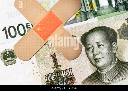 Banknotes, Chinese yuan and a 100 euro note with sticking plasters, symbolic image, China offered help for the euro - Stock Photo