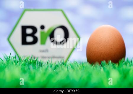 Hen's egg and organic seal, symbolic image, Germany - Stock Photo