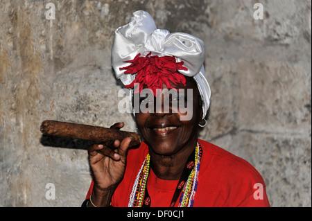 Cuban woman holding a cigar, portrait, central Havana, Centro Habana, Cuba, Greater Antilles, Central America, America - Stock Photo