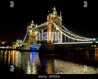 View of the Tower Bridge at night showing the River Thames, London, England, United Kingdom - Stock Photo