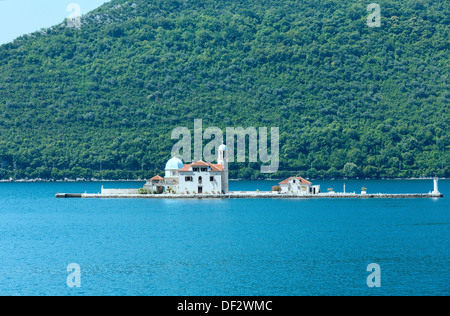 Summer view on artificial island with Roman Catholic Church of Our Lady of the Rocks. Built in 1632y. (Perast town, - Stock Photo