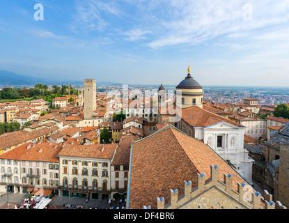 View from Torre Civica (Campanone) over Piazza Vecchia towards Bergamo Bassa with Duomo to right, Bergamo Alta, - Stock Photo