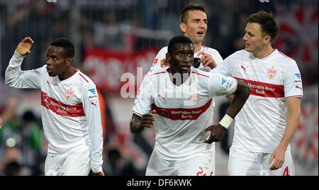 Stuttgart's Ibrahima Traore (L) celebrates his 0-3 goal with Antonio Ruediger (C), Vedad Ibisevic and William Kvist - Stock Photo
