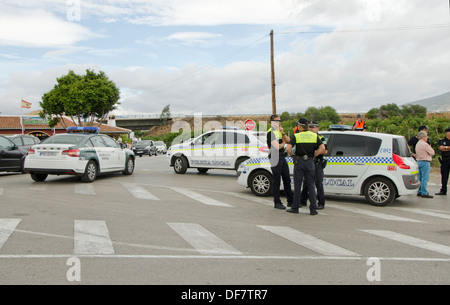 Civil Guards and local police blocking traffic on side of road in Southern Spain. - Stock Photo
