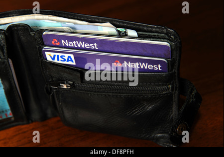 National Westminster NatWest credit cards and Visa debit cards in a wallet - Stock Photo