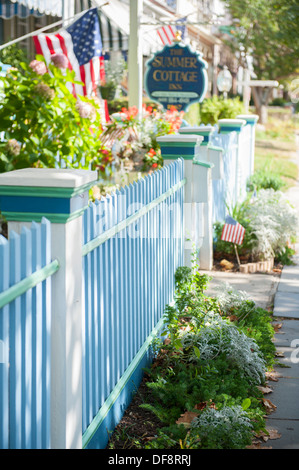 USA New Jersey NJ N.J. Cape May picket fence of a Victorian inn B&B Summer Cottage - Stock Photo