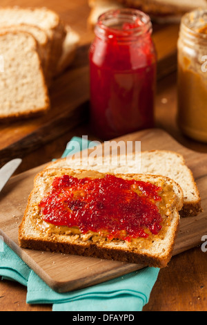 Homemade Peanut Butter and Jelly Sandwich on Whole Wheat - Stock Photo