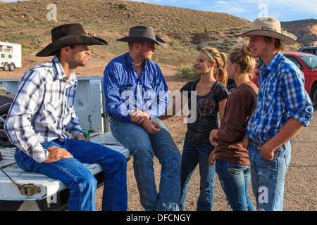 Young men and women in conversation at the rodeo, Rimrock, Grand Junction, Colorado, USA - Stock Photo