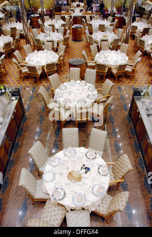 Dining room with prepared tables aboard the Cruise Ship Carnival Fantasy - Stock Photo